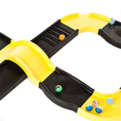 A yellow and black marble track with bridge, all made from ARPRO (expanded polypropylene)