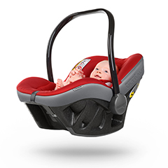Baby sitting in red, grey and black car baby seat