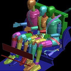 Computerised images and data of two adult test crash dummies on either side of a seat. The child is in the middle of the seat with seatbelts attached.
