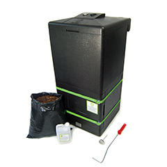 Black HOTBIN compost bin with black sack of compost and tools