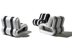 Three modern black and white striped seats that are made from ARPRO (expanded polypropylene)